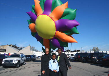 Kenyatta Dearing, a 4th grader from Fleming Academy in Detroit, with her winning Sunflower parade balloon design.